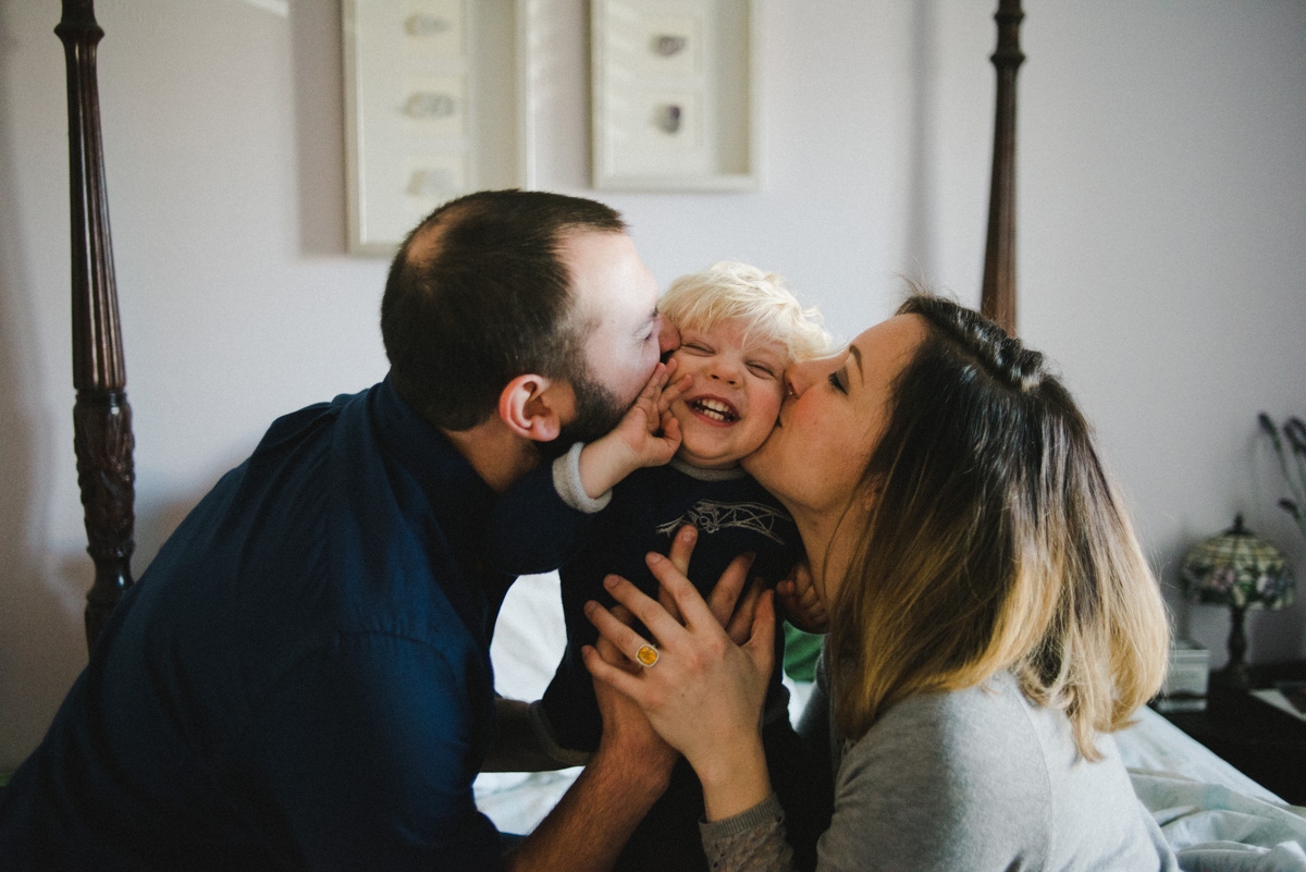 candid family portrait session tells the story of life for this family of 3